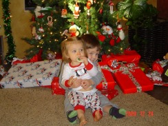 R and H in front of tree at Grandma and Grandpa house 2009